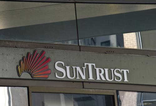 Suntrust Raises Minimums, Prepares To Settle Discrimination Complaint